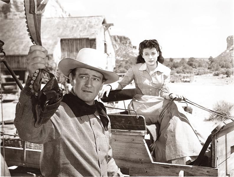 "The ""Bad Man"" hangs up his gun for Quaker Gail Russell."