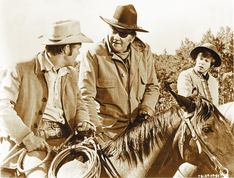 Glen Campbell (left), the Duke and Kim Darby trying to figure out who's in charge.