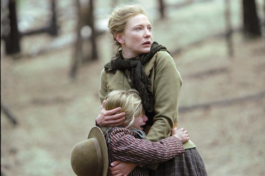 """Maggie hugs close her daughter Dot (Jenna Boyd), who is the point-of-view character throughout the film. """"She is thrust into some horrifying moments,"""" says Howard, """"and to see her navigate them makes you understand the dangers of the times, the fallout of the dysfunction of her family and the mistakes that go back to long before she was born."""""""
