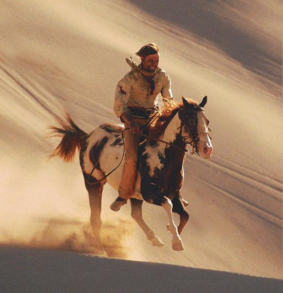 Danish actor Viggo Mortensen, in his first solo lead as Frank T. Hopkins, riding the mustang paint, Hidalgo. Screenwriter John Fusco has moved the equine star onto his ranch, where he also keeps other retired movie horse stars from Young Guns, The Three Amigos and Silverado.