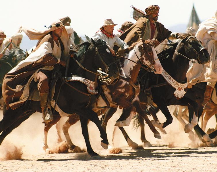 Hidalgo tells the legend of one-time Pony Express rider Frank T. Hopkins (Viggo Mortensen, center) and his mustang, Hidalgo, competing against the world's finest Arabian stallions in what the movie claims was the greatest endurance race ever run: the Ocean of Fire—a 3,000-mile race across the Arabian Desert.– All photos by Richard Cartwright / Touchstone Pictures, Inc. –