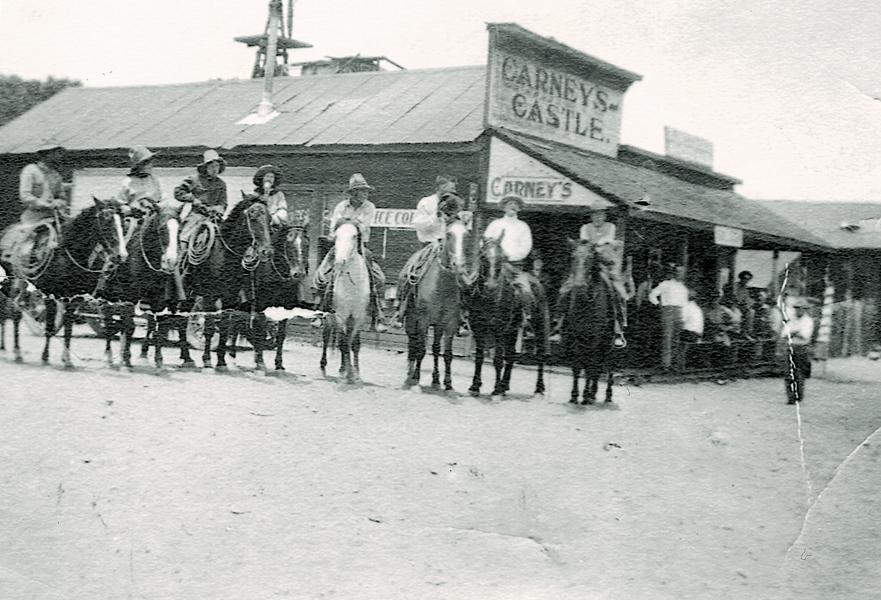 """The legendary Tap Duncan was playing pool with another cowboy in Carney's Castle, a saloon in Hackberry, Arizona, when Tap got tired of missing so many shots (it must be mentioned he was not missing any shots of """"Old Hackberry Bush"""" a favorite liquor in the area), and finally pulled out his six-shooter and shot all the balls straight into the pockets. Legend says he came back the next day and paid for all the damage."""