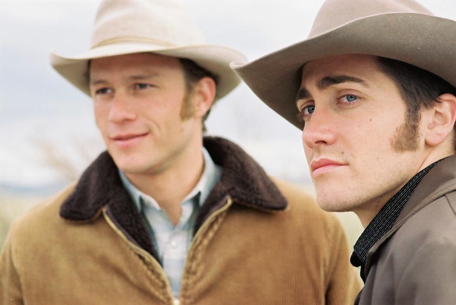 """Heath Ledger (left) plays Ennis Del Mar to Jake Gyllenhaal's Jack Twist in the upcoming gay Western, Brokeback Mountain. """"An achingly sad tale of two damaged souls whose intimate connection across many years cannot ever be properly resolved,""""Variety calls the film, adding that Heath Ledger gives an """"outstanding performance""""; Ledger """"is powerfully impressive as a frightened, limited man ill-equipped to deal with what life throws at him.""""– Courtesy Focus Features / By Kimberely French –"""