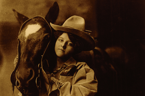 miller-bros-cowgirl-shooting-from-the-hip