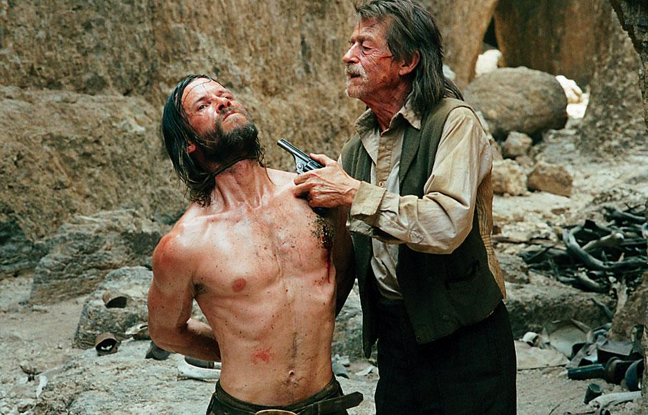 Bounty hunter Jellon Lamb (John Hurt)—a scurvy soul who manages to track Charlie to the Burns camp.