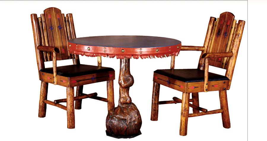 """Molesworth game table has a 341⁄4-inch diameter round top with green leather and red fringed trim with large studs. The burl base measures 291⁄2""""; $15,000. The matching Molesworth armchairs, 381⁄2"""" tall, have black leather seats and a two-panel back with arrow and swastika motif; $10,000. Value of the set: $25,000."""
