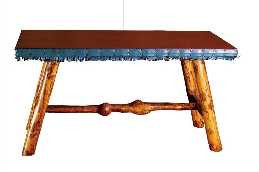 """Molesworth side table has a brown leather top with green-fringed and studded trim. The angled peeled pole legs have a stretcher with burled feet. The table measures 24 x 561⁄2 x 30""""; two tables, that differed in the burled stretcher, both sold for $18,000 bids each."""