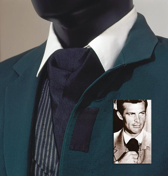 The stylish ascot worn with West's suits, which include a green one, partially shown below (and modeled by West at right).
