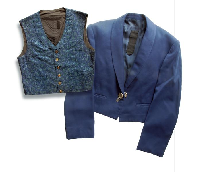 (Above) West's tailored blue jacket and vest. The jacket sports two secret pockets:one behind the left lapel for lock-picking tools; the other under the inside back collar for a throwing knife. Inside his right sleeve?His famous derringer, ejecting from the secret sleeve gun device.– All Spy Show Memorabilia courtesy Danny Biederman –