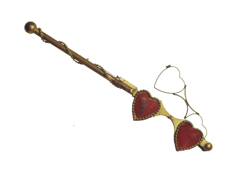 Heart-shaped glasses used by villainess Emma Valentine who schemed to become dictatorial Queen of the United States. Agnes Moorehead was so convincing as the evil matchmaker that she won an Emmy for this role (an award she never earned for her more known role as Endora on ABC's Bewitched).