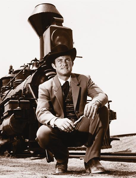 Robert Conrad as the charming secret agent James West. His partner in crime was the amazing gadgeteer Artemus Gordon, played by Ross Martin.– All Wild Wild West images courtesy CBS –