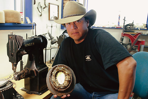 73507078095 Nate Funmaker specializes in making custom beaver fur hats with an 1895  conformitor (in his hand).