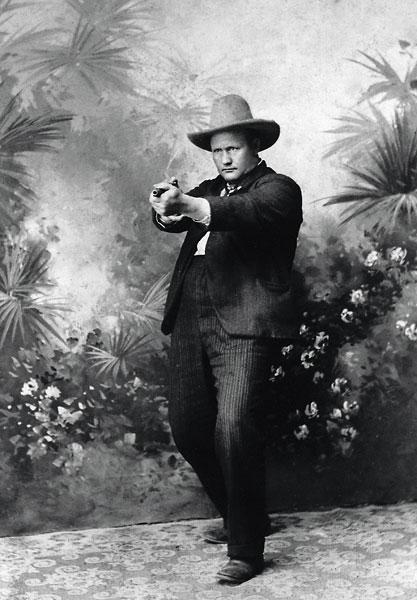 Photos Don't LieLee County Sheriff James S. Scarborough poses with his six-shooter; plagued with outlaws, Lee County citizens voted the shootist in for two terms at the close of the 19th century. Scarborough also served as sheriff of Kelberg County in South Texas from 1914-23. His pistol shooting stance, while seemingly unorthodox, makes us question how early it was that shooters gravitated to this two-handed grip.– All photos courtesy Turner Publishing/Historic Photos of Texas Lawmen by Mike Cox –