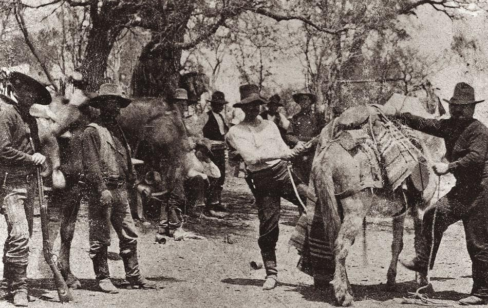 In 1878, San Angelo photographer M.C. Ragsdale took these two excellent photos of Capt. Dan Roberts's Texas Rangers in camp below Fort McKavett in Menard County(the second photo is next in this slideshow). The Ranger at left carries his knife in front of his holster in both photos.