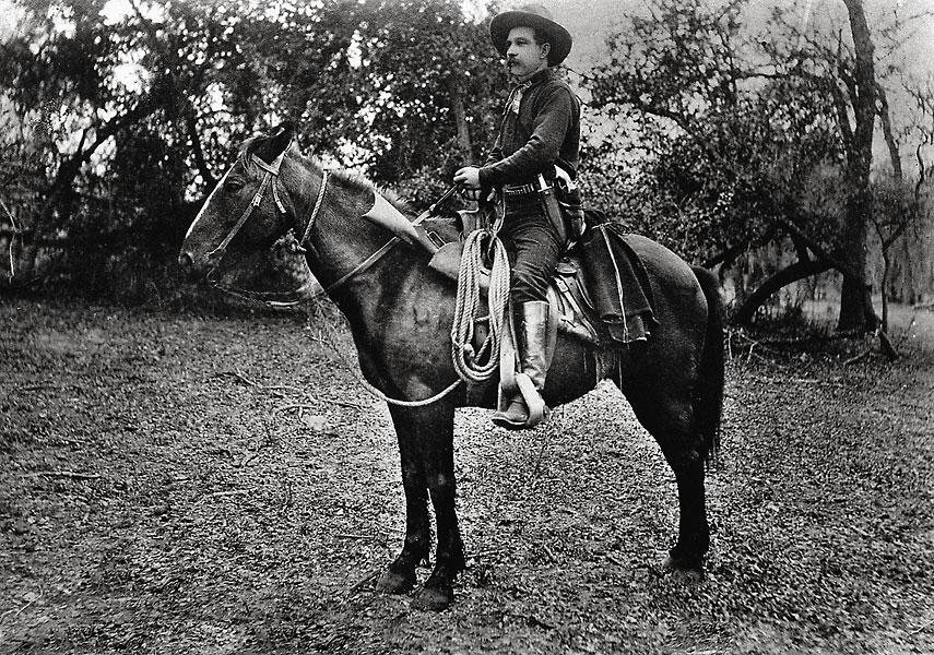 Texas Ranger Ira Aten in 1887. He was involved in several gunfights, and he also appears to favor wearing the knife in front of his pistol and reportedly used a two-handed grip in one of his fights. And yes, he is wearing traditional stove-top boots.