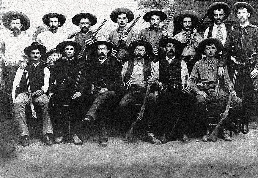Company D of the Texas Rangers in South Texas near the town of Realitos in present-day Duval County. Two Rangers in the front row wear their knives in front of their pistols, but a third (seated, far right) seems uncommitted either way, choosing to place his knife in the middle, at least for the photograph.