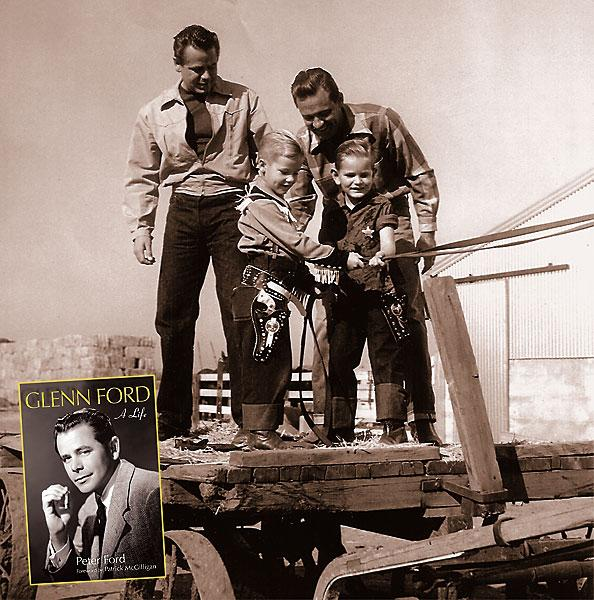 """The Cowboy from QuebecIn his autobiography of his father, Glenn Ford, Peter shares numerous family photos, including this photo of an outing to the Hudkins Bros. Movie Ranch in Burbank, California. Peter stands in front of his father, on the left. Next to them is William Holden and his son, also named Peter. Glenn starred in two Westerns with the elder Holden: 1941's Texas and 1948's The Man from Colorado. Of this photo, Peter tells us: """"Ace Hudkins was a friend of my dad's and owned the ranch. The ranch has since been torn down and is now the famed Forest Lawn Cemetery.""""– Courtesy Peter Ford, from Glenn Ford: A Life, available at GlennFordBio.com –"""