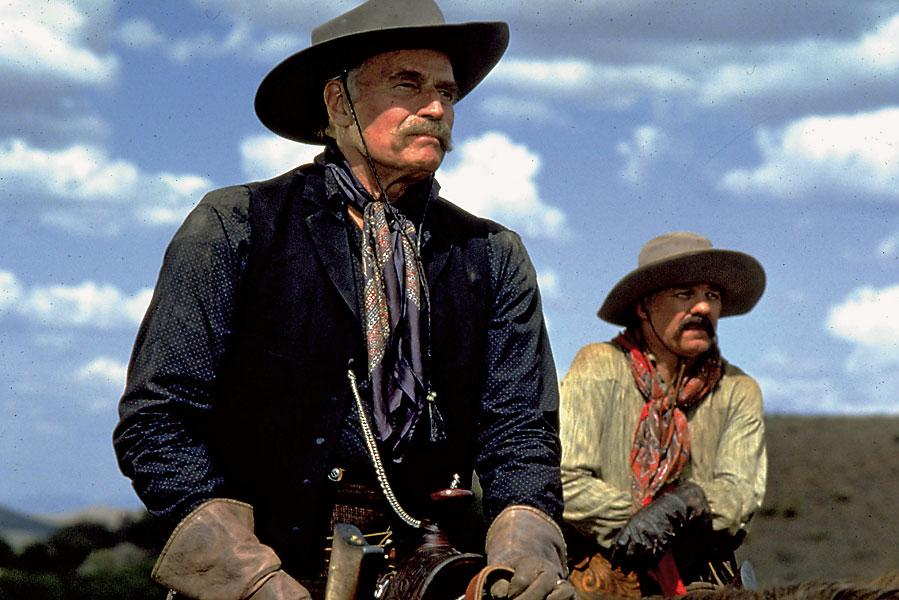 Charlton Heston's role as rancher Henry Hooker (foreground) in Jarre's script was much larger than in the final film, as was Hooker's actual role in Wyatt Earp's life.  Hooker owned 250,000 acres in southeastern Arizona, near Willcox, and the Sierra Bonita Ranch is now a national landmark. Hooker died in 1907, a few weeks shy of his 80th birthday.