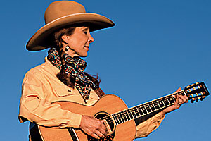 solo_musician_juni_fisher_cowgirl_balladeer_guitar_songwriting
