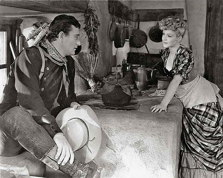 John Wayne and Claire Trevor (who won an Oscar for this part) in a scene from John Ford's Stagecoach, a 1939 film with no final kiss, just a handshake. Henry Fonda and Gene Tierney also went for the romantic handshake in 1940's The Return of Frank James, a 20th Century-Fox picture produced by Darryl F. Zanuck and directed by Fritz Lang.– Stagecoach photo courtesy United Artists –