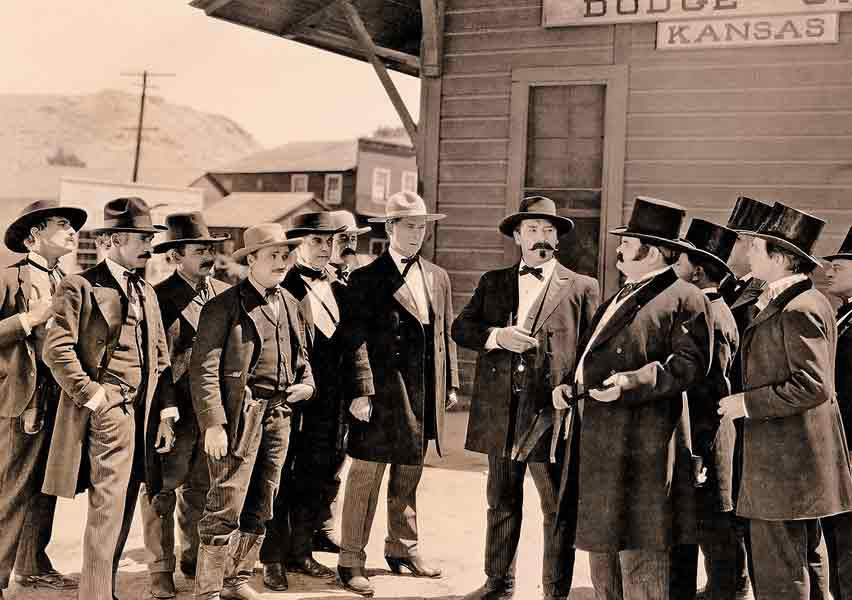 "Bert Lindley as Wyatt Earp in 1923's Wild Bill Hickok.The studio caption reads: ""The Dodge City Peace Commission meets the pompous buffalo hide buyers, the silk hat brigade, from Boston."" William S. Hart as Hickok, Jack Gardner as Masterson and Bert Lindley as Earp make up the commission, with unknown actors in the group playing Doc Holliday, Bill Tilghman, Luke Short and Charlie Bassett."