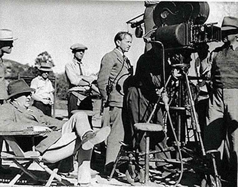 Director John Ford (in chair, far left, on the Stagecoach set) did not direct Stagecoach for 20th Century-Fox, but for United Artists under producer Walter Wanger.