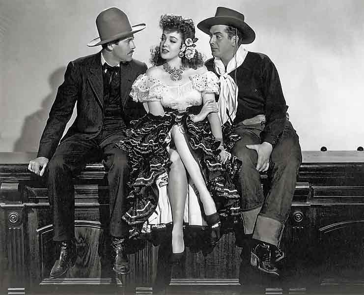Henry Fonda as Wyatt Earp and Victor Mature as Doc Holliday gaze admiringly at saloon gal, Chihuahua,  played by the lovely Linda Darnell in My Darling Clementine.