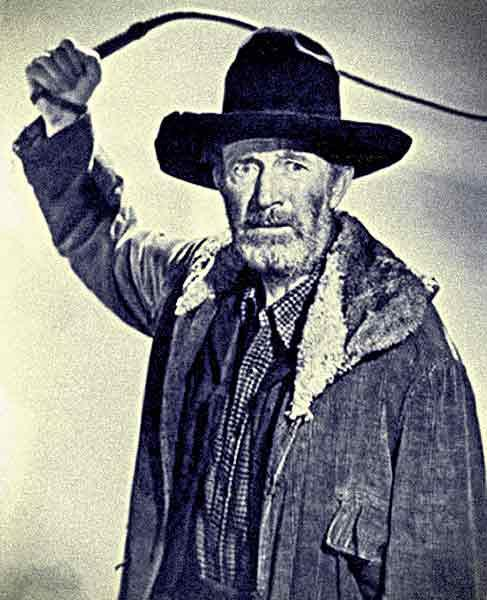 Three-time Oscar-winner Walter Brennan as Pa Clanton, the meanest, low-down rattlesnake of a character he ever played