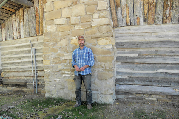The hand saw man true west magazine for Log cabin restoration