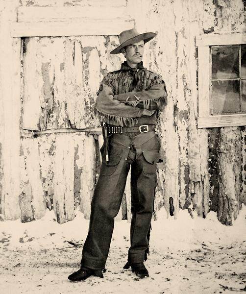 Henry Boyle, a British barrister and the second son of an Irish noble family, poses in Fort Macleod, showing off his new buckskins for photographer George Anderton. Boyle and his brother, Lord Richard, were aristocratic investors in the Alberta Ranche and Rocky Mountain Ranger officers. Courtesy Glenbow Archives NA-4452-7