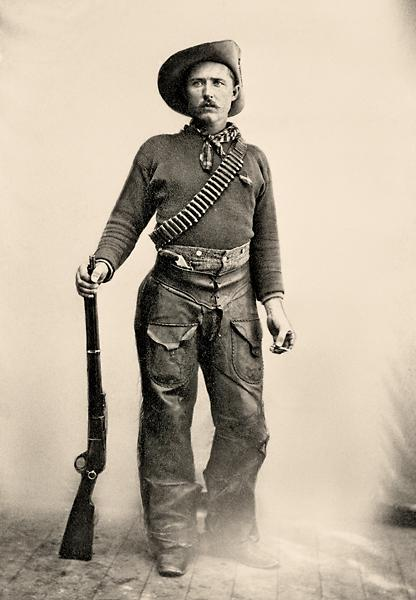 This Ranger, whose identity is lost to time, is dressed in functional cowboy gear that is typical of clothing worn by the Rocky Mountain Rangers. His hat identifies the one concession to military dress code: the upturned brim signifies affiliation with the Canadian Militia. The 1876 Winchester .45-75 was the Rangers weapons of choice (the original photo has been monkeyed with and the cutter is missing from the trigger guard). This Ranger also has a Smith & Wesson New Model No. 3 single-action revolver tucked in in his chaps. Courtesy Glenbow Archives NA-670-5