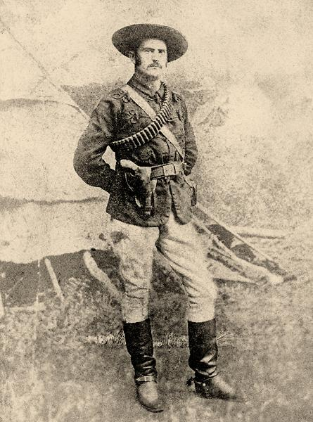 The commanding officer of the Rocky Mountain Rangers, Maj. John Stewart, displays the greatest effort at military comportment in uniform high military boots, Buermann-style civilian spurs, white riding breeches, a deep blue woolen tunic (in the pattern of his old regiment, the Princess Louise Dragoon Guards), a civilian belt with a double-loop holster holding what appears to be a Smith & Wesson revolver, a white haversack and a leather bandolier, all capped with a wide-brimmed hat. Courtesy Glenbow Archives NA-1724-1