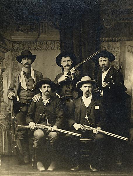 These are some U.S. marshals who also worked the Indian Territory. After five years evading the law, the accused murderer of Deputy Daniel Maples, Ned Christie, met his maker when he was shot down by 16 posse members, including these marshals: Charles Copeland and Capt. G.S. White (front row, from left); Bill Smith, Bill Ellis and Paden Tolbert (back row). Out of more than 200 marshals who have been killed in the line of duty since President George Washington founded the U.S. marshals, more than half of them died serving in the Indian Territory area of Fort Smith. Courtesy Fort Smith National Historic Site