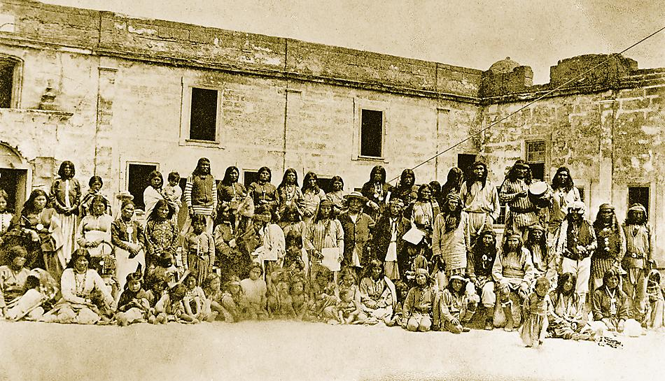 Apache tribal members as prisoners of war at Fort Marion in St. Augustine, Florida. On October 1, 1886, Lt. Col. Loomis L. Langdon reported that 469 Indians, including adults, children and 14 paid scouts, were confined at the fort.– Courtesy National Museum of the American Indian, Smithsonian Institution 09508 –