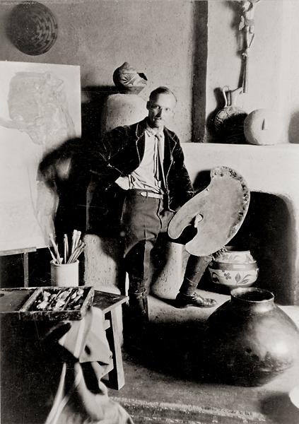 Taos, New Mexico, is still very much E.L. Blumenschein's town, even though the artist died more than 50 years ago. His south light studio on Ledoux Street, where he stands in the shown 1923 portrait, is now the E.L. Blumenschein Home and Museum.– Courtesy E.L. Blumenschein Home and Museum –