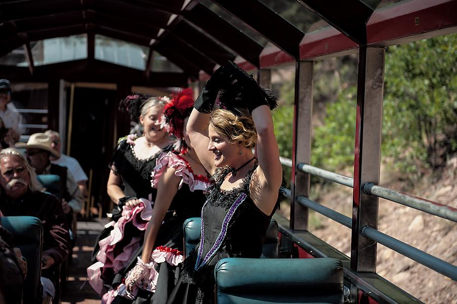 Can-can girls dance for Railfest guests during an excursion to Cascade Canyon in a railcar operated by the Durango & Silverton Narrow Gauge Railroad.– True West Archives –