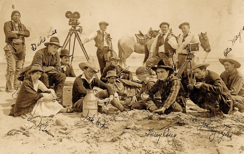 "Early Film CrewRodeo cowgirl Vera McGinnis's photo album includes this rare photo of a young John Ford (seated fourth from left, with cowboy hat) and Harry Carey Sr. (seated third from right). Harry Carey Jr., who died on December 27, 2012, said the photo looked to be taken in 1917, in Placerita Canyon near Newhall, California, where the duo had filmed many of their early films. Carey Sr. and Ford made 26 silent Westerns, but only three have survived. Sadly, the rest ""rotted in the cans,"" Carey Jr. told True West. ""Nobody bothered to even try and save 'em.""– courtesy Jendreau family collection –"