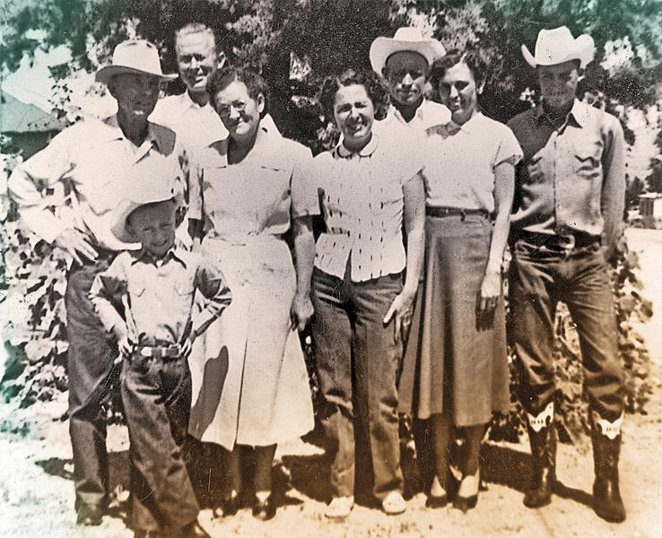 """That's me, front left, standing in front of Ernie and Grandma """"Guessie"""" Swafford, around the time she told me we were related to outlaws. Next to them are Mary Hamilton, my mother, Bobbie, and Billy Hamilton. In the back is my father, Allen P. (without a hat), and Uncle Choc Hamilton. This photo was taken in 1956, not long after our arrival back in Kingman."""