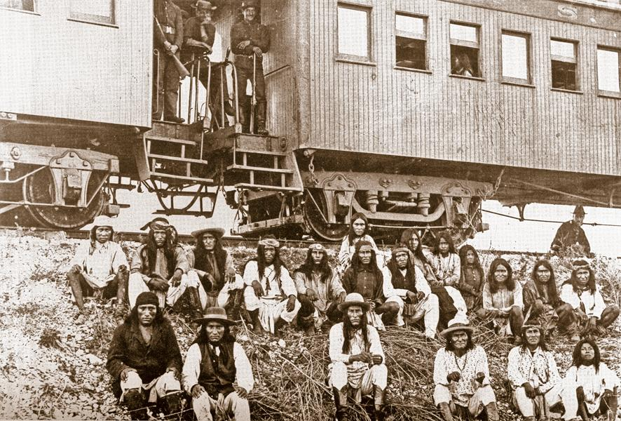On September 10, 1886, Geronimo's band of Chiricahua Apaches rested at a stop near the Neuces River in Texas, waiting to board the train that would take them to reservations in Florida. Nearly 400 Apache prisoners were transported overall. Cochise's youngest son, Naiche (first row, third from left), and Geronimo (first row, fourth from left) were held at Fort Pickens until 1888.– True West Archives –