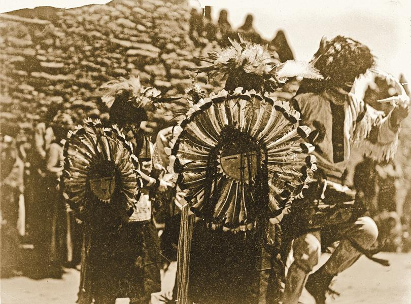 """Tewa Buffalo DancersDuring his visit to the Tewa pueblos in New Mexico, photographer Edward S. Curtis learned of the Buffalo Dance, celebrated in January. Painted black above the waist and wearing a hat of buffalo hair and horns, the dancers, he wrote, portrayed the """"actions of the buffalo, hunted, stampeding, charging, drooping with exhaustion, reviving for another effort to escape….""""– Courtesy Library of Congress –"""