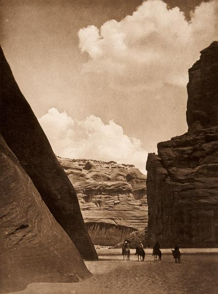 """Cañon del MuertoNavajos at Cañon del Muerto, 1908, is an Edward S. Curtis photograph among others on rotation at Tucson's Arizona State Museum through July 18, 2015. A prehistoric Indian burial ground was found here in 1882; the canyon is now part of Canyon de Chelly National Monument in Chinle.– Courtesy Arizona State Museum's """"Curtis Reframed"""" exhibit, now through July 18, 2015 –"""