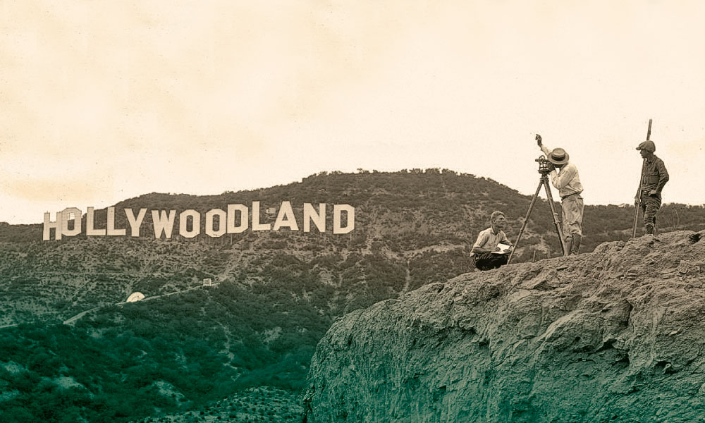 "The Hollywood sign was erected in 1923 for $21,000, spelling out Hollywoodland, as an advertisement for a local real estate developer. Originally meant to be exhibited for a year and a half, the cheesy sign took on a new significance with the rise of American cinema. In 1949, the Hollywood Chamber of Commerce repaired the sign and removed the word ""land."""