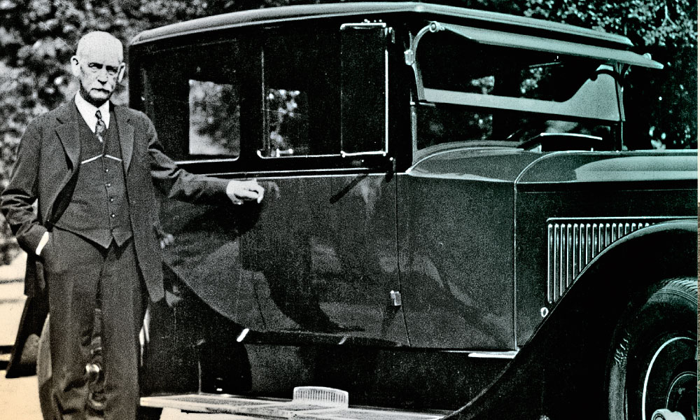 "Wyatt Earp stands next to a 1926 Packard Model 326 ""Opera Coupe"" that is believed to have been owned by silent film actor William S. Hart. Tom Mix preferred flashier cars and spared no expense when he went out on the town with Wyatt—the actor was making $7,500 a week at Fox, with virtually no income tax! – Courtesy Jeff Morey –"