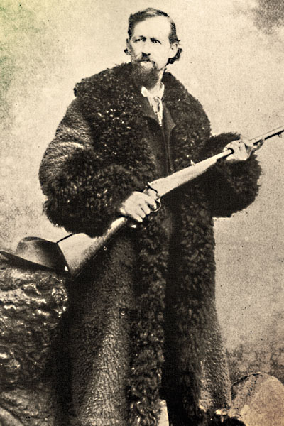 "A contributor to the slaughter, Charles ""Buffalo"" Jones wears a buffalo coat, a heavy and super warm overcoat mainly worn on the frontier by stagecoach drivers and other folks who had to sit in the cold for extended periods. – True West Archives –"