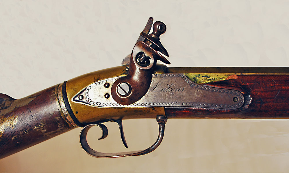 The VMI Museum contains evidence that suggests that Meriwether Lewis may have had this Lukens air gun (shown here) on the Western expedition. The gun has an air chamber in the butt and is fully stocked, with a brass octagon barrel and wood ramrod. The butt of the rifle is a hollow canister storing compressed air between 700 and 900 pounds per square inch. A needle valve holds air until the trigger is pressed. Air is added back by a hand pump. – Courtesy Henry Stewart Collection, Virginia Military Institute Museum, 1988.0031.007 –