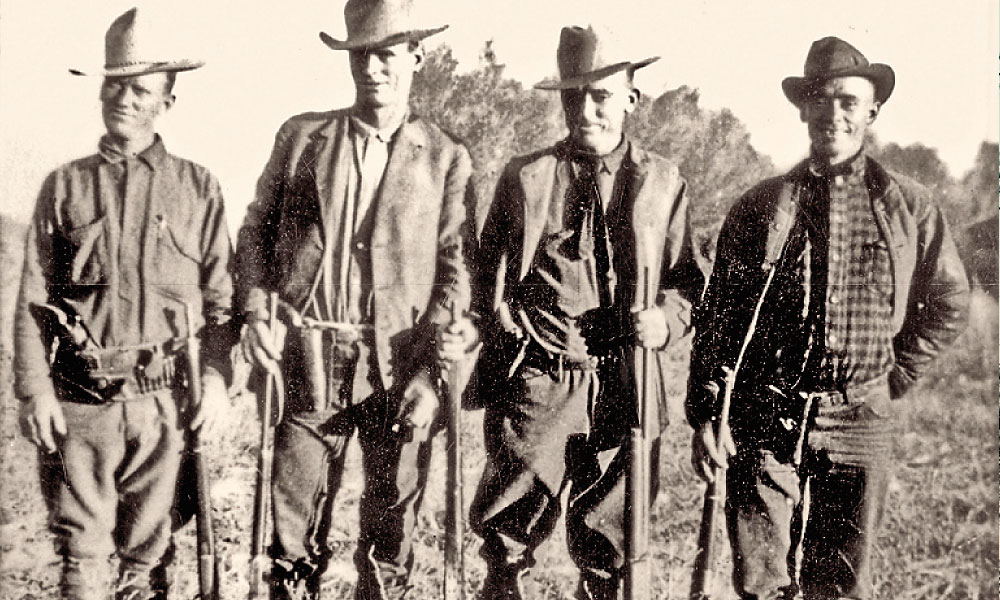 The Fenn Brothers in a 1924 photo represented yet another group searching for Apaches in Mexico's Sierra Madre, southern Arizona and New Mexico. (From left) Joe, Moroni, Alvah and Pete. – Courtesy Lynda A. Sánchez/Eve Ball Collection –