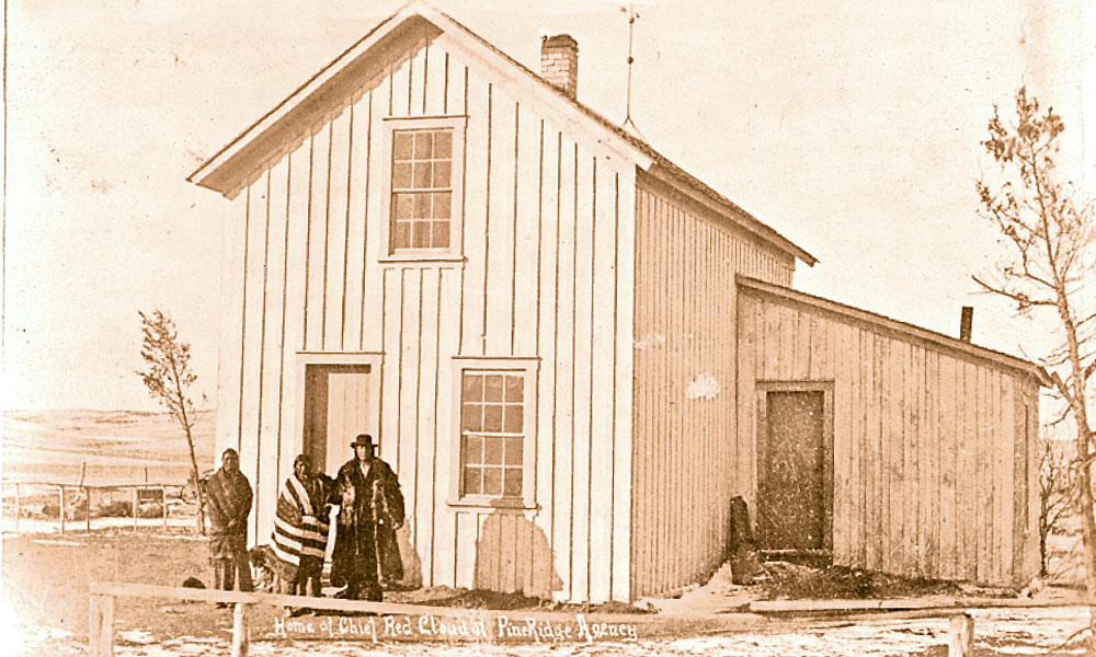 In 1890, Red Cloud (right) with his wife, Pretty Owl, and an unidentified man were photographed outside his two-story home on the Pine Ridge Reservation in South Dakota. – W.R. Cross/Courtesy Library of Congress –