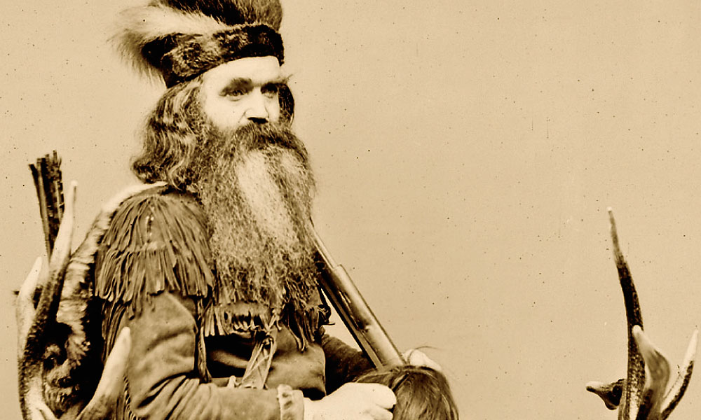 """With North American beaver fur trade collapsing in the 1840s, mountain man Robert Newell lamented, """"The fur trade is dead in the Rocky Mountains...."""" In his 30s at the time, Seth Kinman (seated in one of his famous chairs) crossed the plains into California, where he lived and hunted until he died, in 1888, after accidentally shooting himself in the leg. – True West Archives –"""