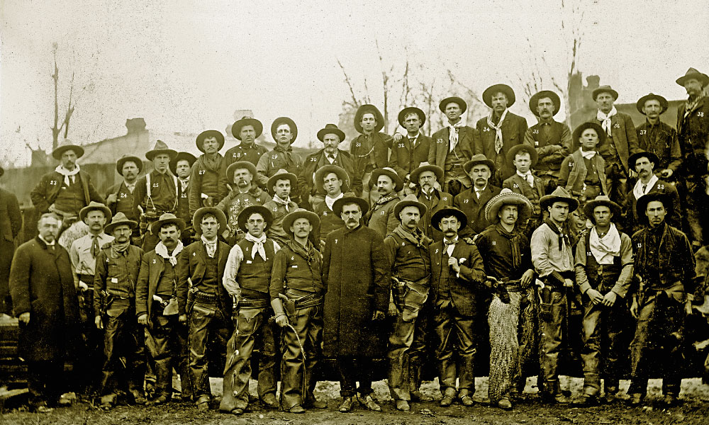 Captain Seth Bullock & Cowboys On March 4, 1905, President-elect Teddy Roosevelt's friend and fellow Rough Rider Seth Bullock organized a group of cowboys to participate in the inaugural parade. The image's owner, Richard Wadsack, believes the man who is not marked (first row at right) may have been Prince, the photographer who set up the shot, as his label is placed near this man on the original print. – Courtesy Richard Wadsack –