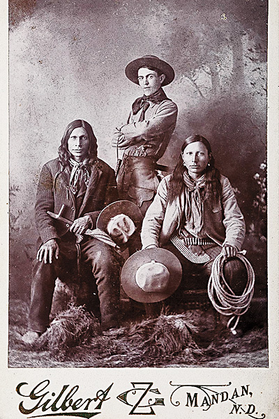 Born in 1885, Wild West show trick roper Bee Ho Gray taught Will Rogers an innovative rope catch that had earned Gray a world champion title. Rogers performed the trick, catching a galloping horse and rider with three ropes, in 1922's The Ropin' Fool. Gray is flanked by two Indians in this photo that sold for a $600 bid on July 13, 2015, at Cowan's Auctions.